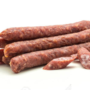 Hungarian dry sausages pepperoni with three cut pieces isolated on white background smoked in natural casing mixed pork and beef